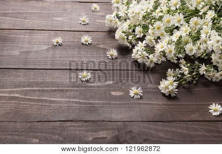 White cutter flowers are on the wooden background.
