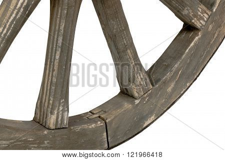 Left closeup side view of weathered vintage wooden spokes and rim of wagon wheel on white