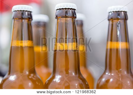 Close-up of glass bottles full of beer on a craft beer elaboration process