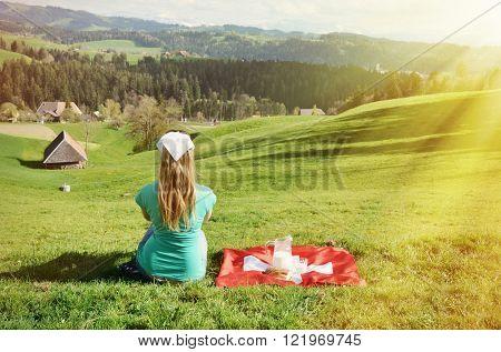 Jug of milk on the Swiss flag. Emmental, Switzerland