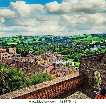 landscape with roofs of houses in small tuscan town in province Italy poster