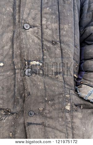 man dressed in shabby old worn working clothes with patches and put his hand in his pocket full of holes poster