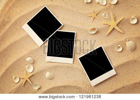Summer empty polaroid photo card on a sea sand. summer background