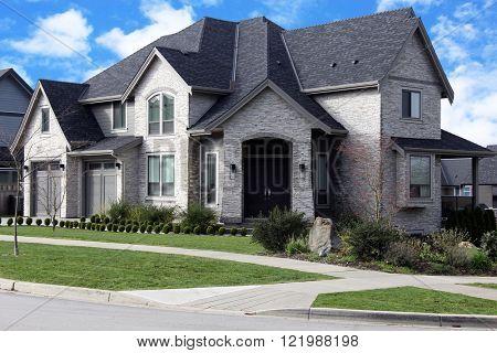 New Executive suburban house on a sunny day.