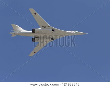 Moscow - 7 May 2015: White Tu-160 White Swan on the codification of NATO: the Blackjack a supersonic bomber-missile in flight against a blue sky May 7 2015 Moscow Russia