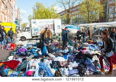 Amsterdam-April 30: Unidentified people buy clothes in a sale on daily Flea market Waterlooplein (Waterloo Square) on April 302015 the Netherlands.