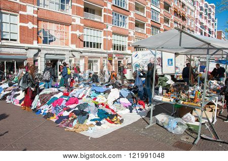 Amsterdam-April 30: Sale second-hand clothing on daily Flea market on Waterlooplein (Waterloo Square) merchants display their bric-a-brac for sale on April 30 2015 the Netherlands.