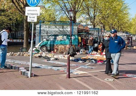 Amsterdam-April 30: Famous daily flea market on Waterlooplein merchants display bric-a-brac and old books for sale on April 30 2015 the Netherlands.