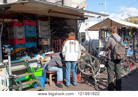 Amsterdam-April 30: Flea market on Waterlooplein merchants display their bric-a-brac and old bikes for sale on April 302015 the Netherlands.