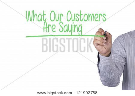 Man Hand writing What Our Customers Are Saying with marker on visual screen. Isolated on sky. Business technology internet concept. Stock Photo