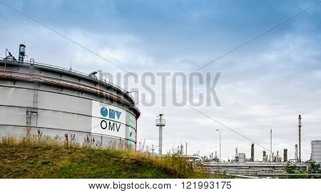 VIENNA AUSTRIA - CIRCA 2016: OMV - Osterreichische Minerallverwaltung white petrol tankers of the petroleum factory. OMV is an integrated international oil and gas company headquartered in Vienna. It is active in the upstream (Exploration and Production)