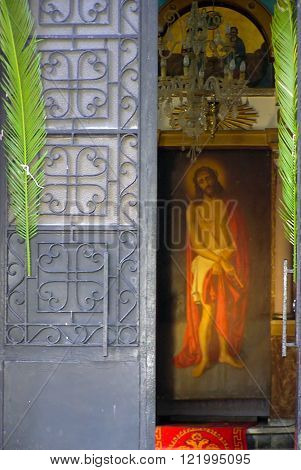 The full length icon of Jesus Christ as it appears behind the front door of a Greek-Orthodox church
