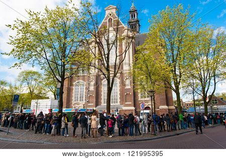 AMSTERDAM-APRIL 30: People stand in a queue to the Anne Frank House Museum on April 30,2015.The Anne Frank House Museum is one of Amsterdam's most popular and important museums opened in 1960.