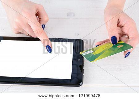 Woman Enters Credit Card Details A Tablet Pc