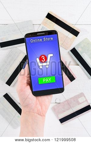 Woman Holds A Smartphone And Pay For Goods In The Online Store