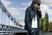 Fashion style photo of a man talking over cellphone poster
