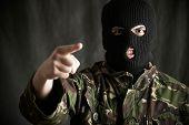 Portrait Of Threatening Terrorist Wearing Balaclava Addressing Camera poster