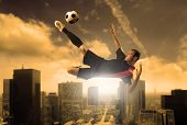 soccer player in action on a city background poster
