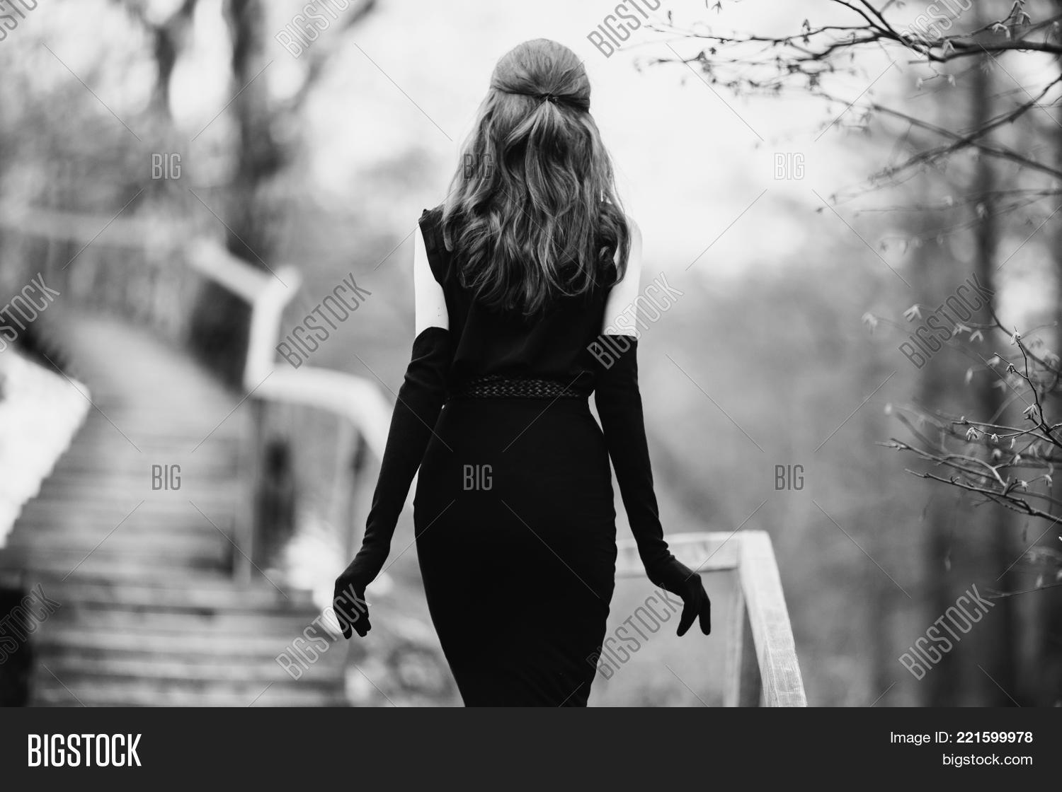 Black and white art monochrome photography striking girl with long hair in black clothes