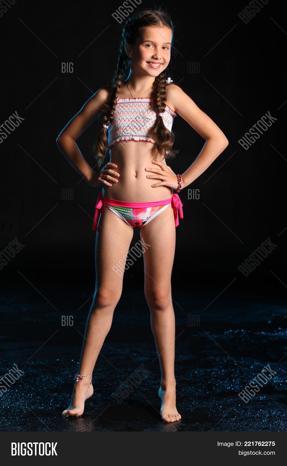 Happy Young Teenage Girl In A Swimsuit Stands Barefoot On A Black Background Pretty Child