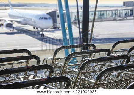 Trolleys at international airport. Runaway and finger. Travel background. Horizontal