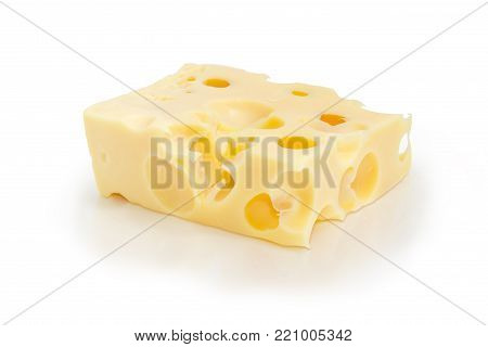 Piece of the Swiss cheese with large holes known as cheese's eyes on a matte surface on a white background