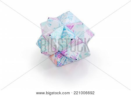 Small triambic icosahedron - one of the species of polyhedra, geometric figure made by method of modular origami with paper on a matte surface on a white background