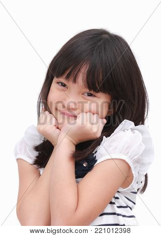 Cute asian kid girl express happy face and raise her hand on her cheek. Put on a black white T-shirt with little flower. Portrait image on isolate white background.