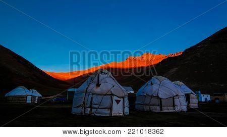 Sunrise over kyrgyz Yurts at Tash-Rabat river and valley at Naryn province, Kyrgyzstan