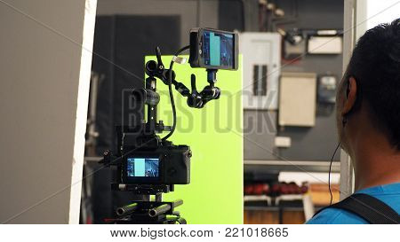 Behind Video Camera And Green Screen