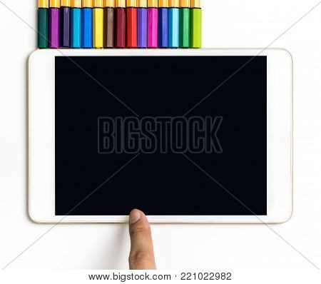 Finger touching on touch screen tablet with color pencil for Art concept mock up