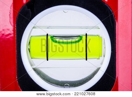 Spirit level bubble close up showing perfectly level alignment. Workman tool for finding the horizontal