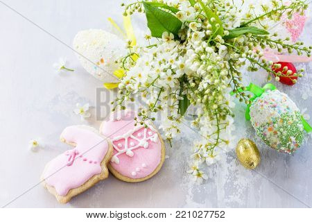 Easter Background. Colorful Easter Background With Colored Eggs And Sweets On A Gray Stone Backgroun