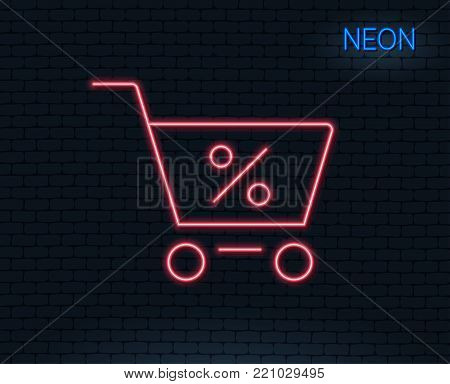 Neon light. Shopping cart with Percentage line icon. Online buying sign. Supermarket basket symbol. Glowing graphic design. Brick wall. Vector