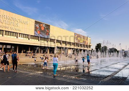 MOSCOW, RUSSIA - AUGUST 02, 2017: People Having a Rest on Steps and Walking between Fountains near the New Tretyakov Gallery of Modern Art on Krymsky Val on August 02, 2017 in Moscow, Russia