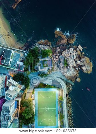 drone view of football court by the ocean