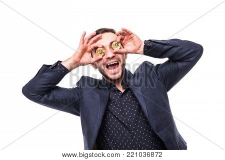 Crazy Ecxited Young Sucessful Man Cover Eyes With Golden Bitcoins Isolated On White Background