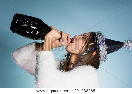 drunk girl drank the rest of champagne on white background