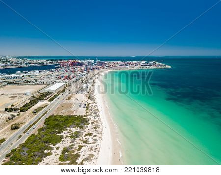 A busy Port Beach, Fremantle, on a stunning summer afternoon with turquoise water. Perth, Western Australia, Australia. Port Beach is a popular destination for locals and tourists visiting Perth.