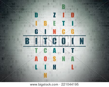 Blockchain concept: Painted blue word Bitcoin in solving Crossword Puzzle on Digital Data Paper background