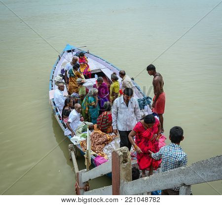 Varanasi, India - Jul 12, 2015. Tourist boat on the Sacred Ganges River in Varanasi, India. Varanasi is the holiest of the seven sacred cities (Sapta Puri) in Buddhism, Hinduism and Jainism.