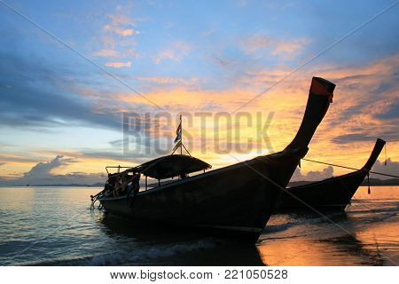 The longtail boats near to a beach during a sunset. Krabi, Thailand.