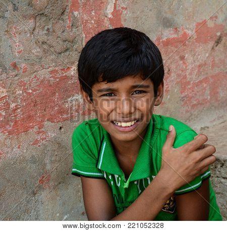 Varanasi, India - Jul 12, 2015. Portrait of an Indian boy in Varanasi, India. Varanasi is the holiest of the seven sacred cities (Sapta Puri) in Buddhism, Hinduism and Jainism.
