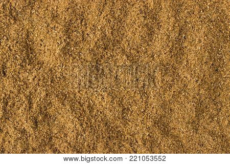 texture of Cumin powder close-up, spice or seasoning as background