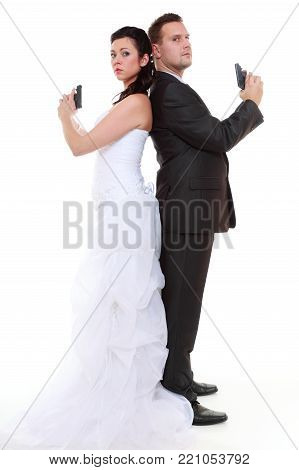 Bad relationship concept - married couple problem discord. Bride and groom with handgun. Man woman in disagreement. Isolated on white background