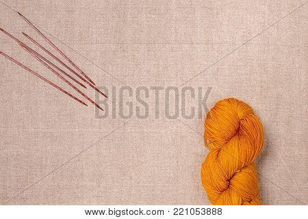 Semi-solid medium orange yarn color for socks. Hand dyed yarn, mini skein, sock fingering yarn on canvas background.