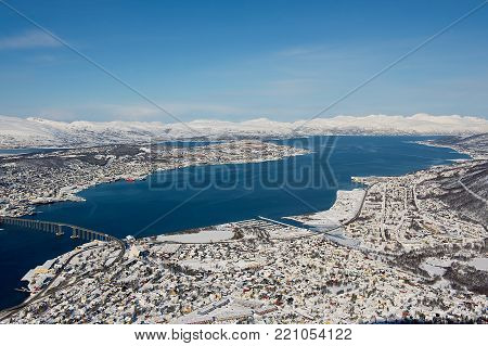 Aerial view to the city of Tromso, 350 kilometers north of the Arctic Circle, Norway.