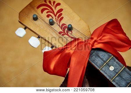 Russian wooden balalaika with bow close up