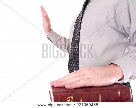 a man taking a oath on bible.