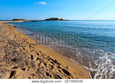 Isola delle Correnti and Capo Passero summer sandy sea beach (Portopalo, Siracusa, Sicilia, Italy),  the most southern point in Sicily.